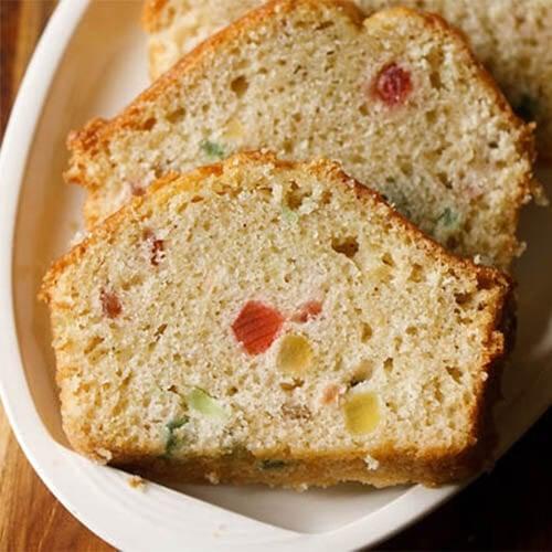 tutti frutti cake slices on a white oval platter