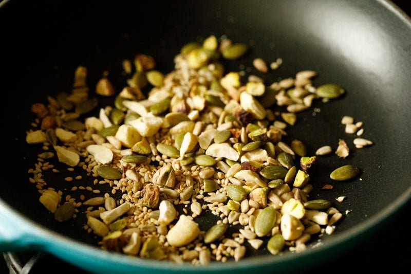 raw nuts and seeds added to pan