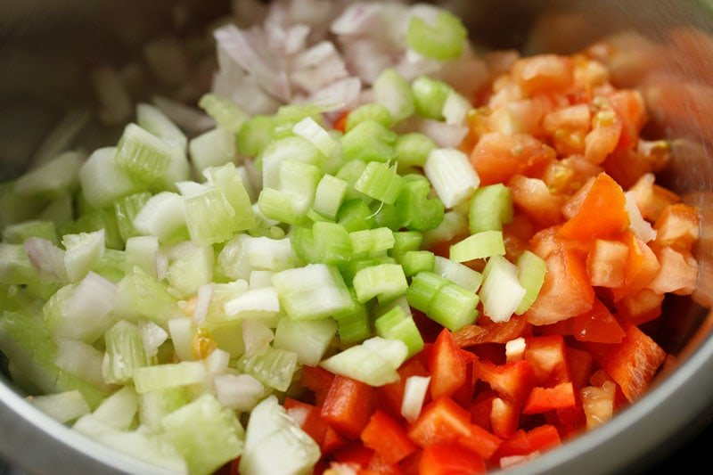 chopped vegetables added to large mixing bowl