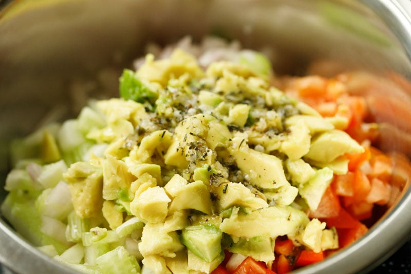 avocado and dressing added to mixed veggies