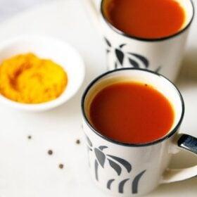 two cups of turmeric tea